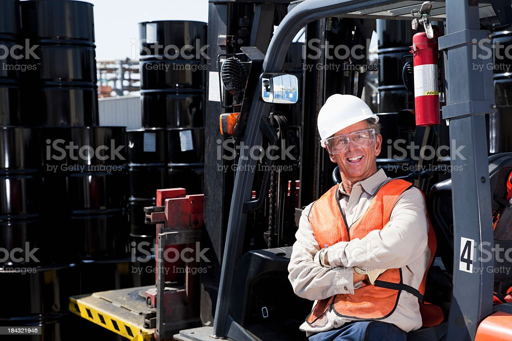 Industrial worker with forklift stock photo