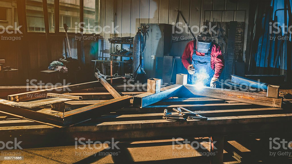 Industrial worker with welding tool stock photo