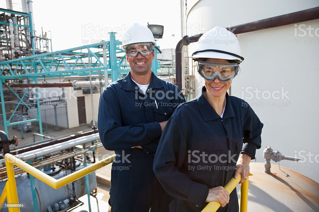 Industrial workers in manufacturing plant royalty-free stock photo