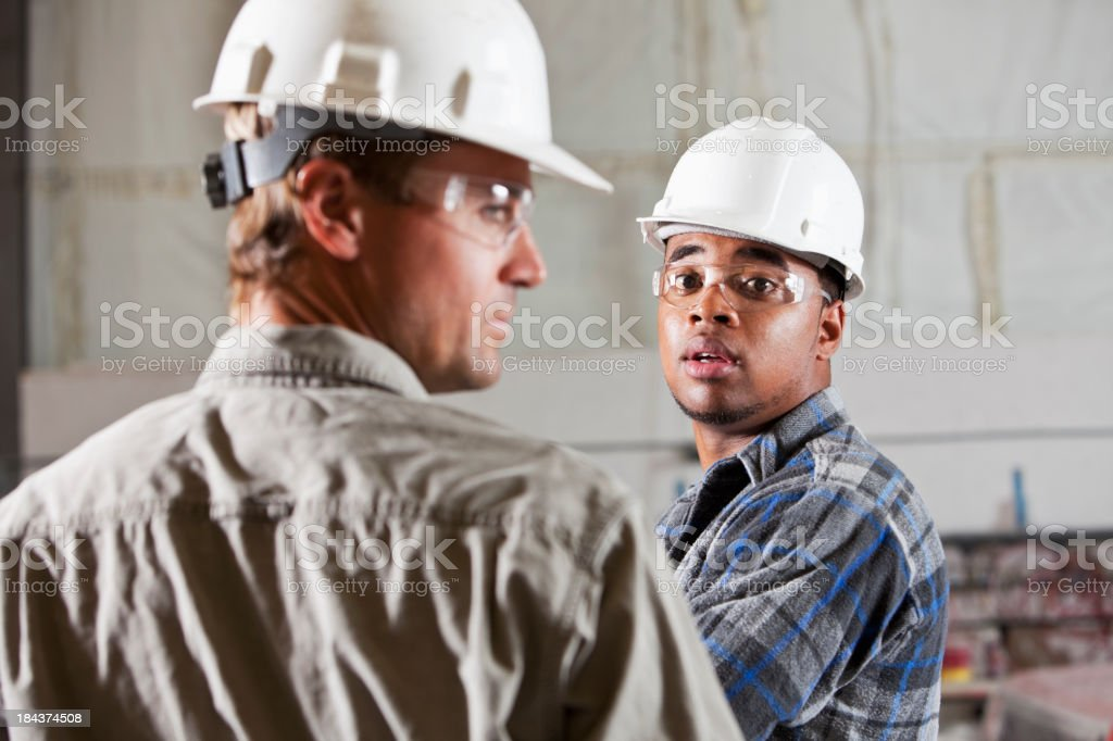 Industrial workers in warehouse royalty-free stock photo
