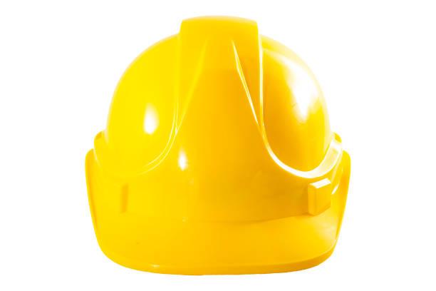 Concepto de equipos de seguridad de trabajadores industriales o sitios de construcción con vista frontal de un casco amarillo aislado sobre fondo blanco con un recorte de trayectoria de clip - foto de stock
