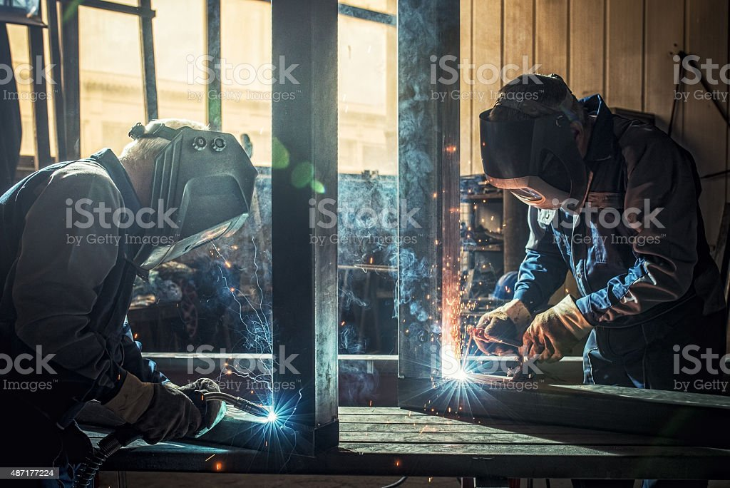 Industrial workers with welding tools stock photo