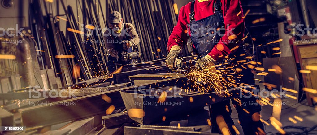 Industrial workers with work tools stock photo
