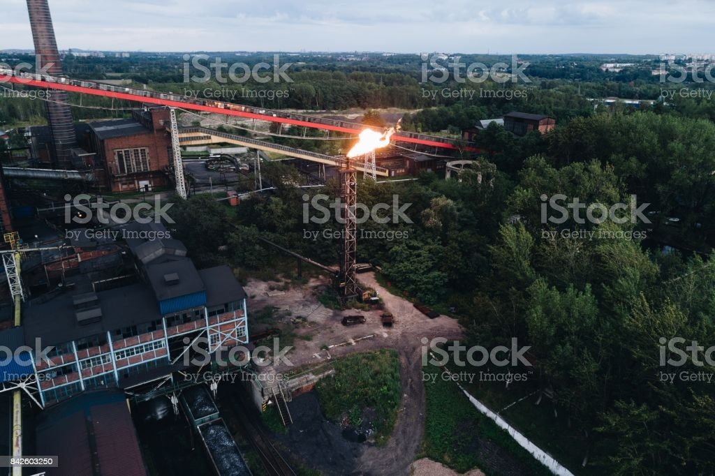 Industrial zone. Aerial view on old working cooking plant. stock photo
