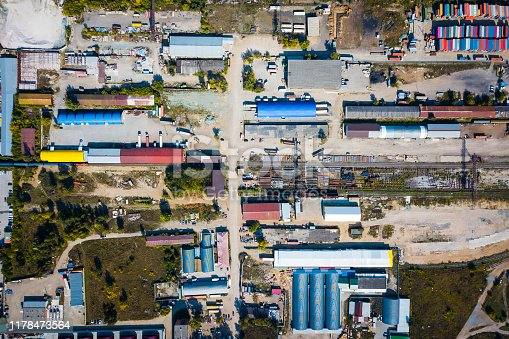 Top view of the industrial zone: garages, warehouses, containers for storing goods. The concept of storage of goods by importers, exporters, wholesalers, transport enterprises, customs
