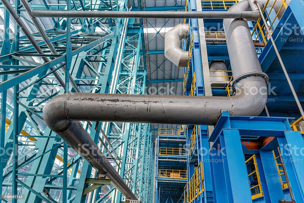 Industrial zone, steel pipelines and cables  in a  plant royalty-free stock photo