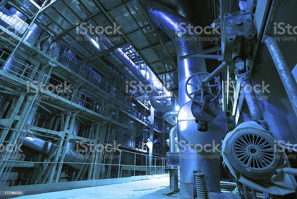 Industrial zone, Steel pipelines and cables in blue tones royalty-free stock photo