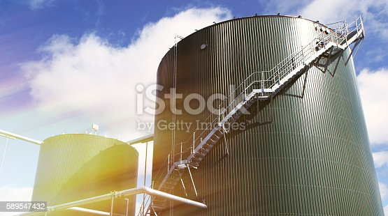185665781 istock photo Industrial zone, Steel pipelines and tanks against blue sky 589547432