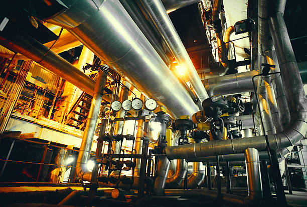 industrial zone, stahl pipelines in blauen farben  - luftventil stock-fotos und bilder