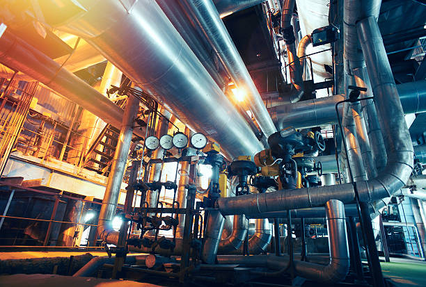industrial zone, steel pipelines, valves and gauges - factory stock photos and pictures