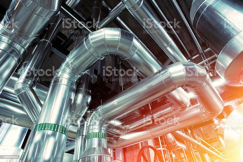 Industrial zone, Steel pipelines, valves, cables and walkways stock photo
