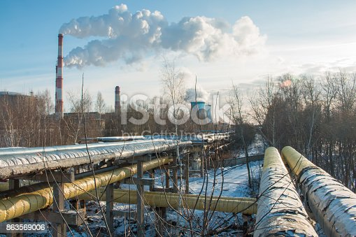 istock industrial zone, water and smoke pipes, heat loss winter, environmental pollution 863569006