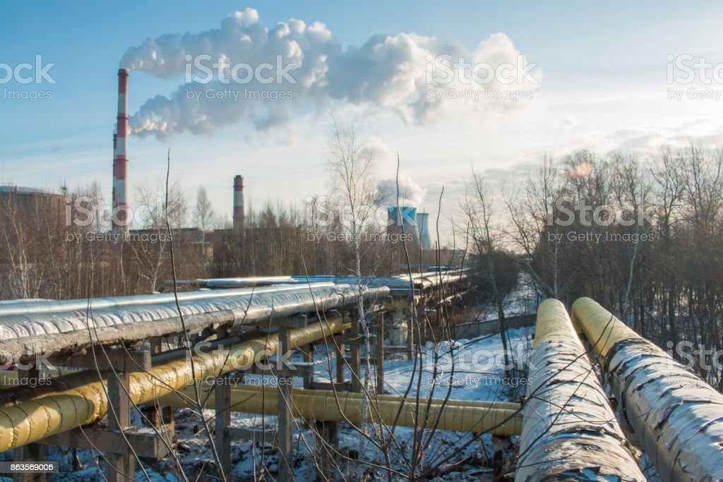 industrial zone, water and smoke pipes, heat loss winter, environmental pollution stock photo