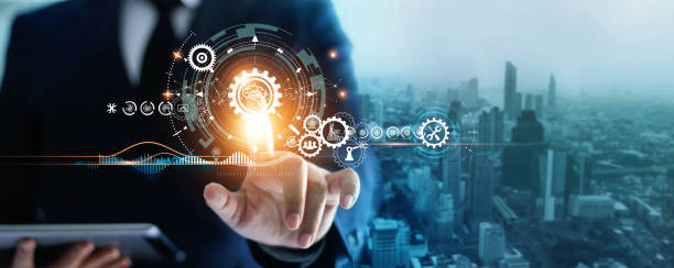 Industry 4.0, Businessman touching brain in cogwheel, Innovative and futuristic, Business process workflow development and optimisation of construction industrial on city background. stock photo