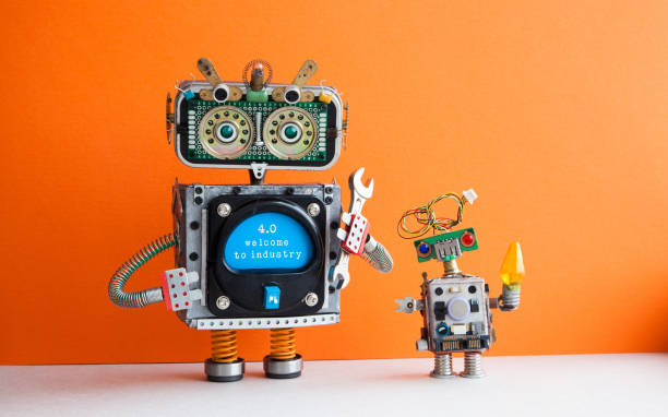 Industry 4.0 concept. Big IT specialist robot with hand wrench and small robotic cyborg. Welcome to the new economic future message on blue display. Orange wall background - foto stock