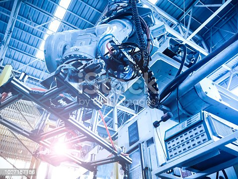 istock industry 4.0 concept from automatic robotic arm use for support high efficiency production in manufacturing factory 1027187186