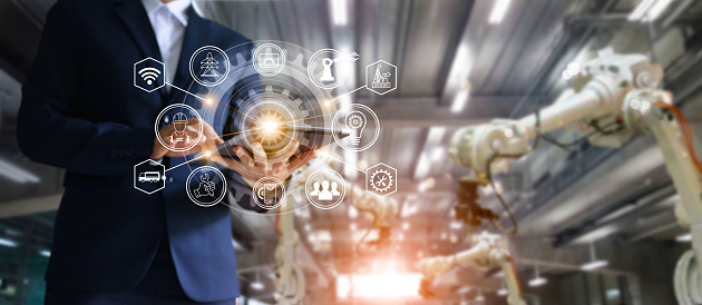 istock Industry, 4.0 concept, Icon flow automation and data exchange in manufacturing technology, Manager industrial engineer using tablet check and control automation robot arms machine in intelligent factory industrial on system software interface. Welding rob 1022854924