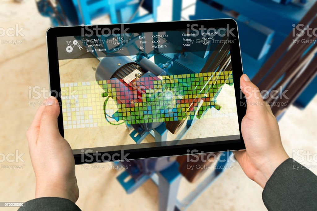 Industry 4.0 concept .Man hand holding tablet with Augmented reality screen software for measure temperature of motor in smart farm background stock photo