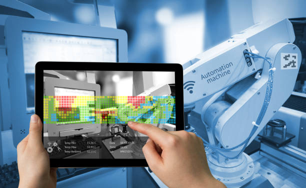 Industry 4.0 concept .Man hand holding tablet with Augmented reality screen software and blue tone of automate wireless Robot arm in smart factory background - foto de acervo