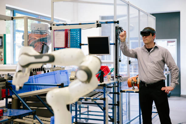industry 4.0: engineer works with a head-mounted display stock photo