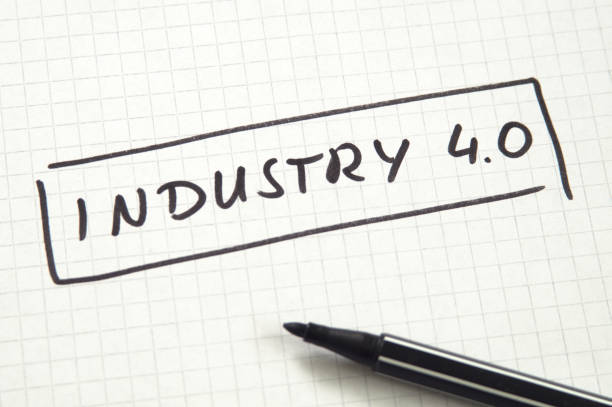 industry 4.0 in handwriting on checkered paper with black felt pen - industrial revolution stock pictures, royalty-free photos & images