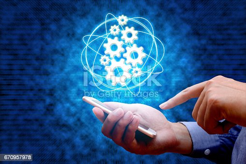 1150202730istockphoto Industry 4.0, industrial internet of things concept with man using smart phone and binary background. 670957978