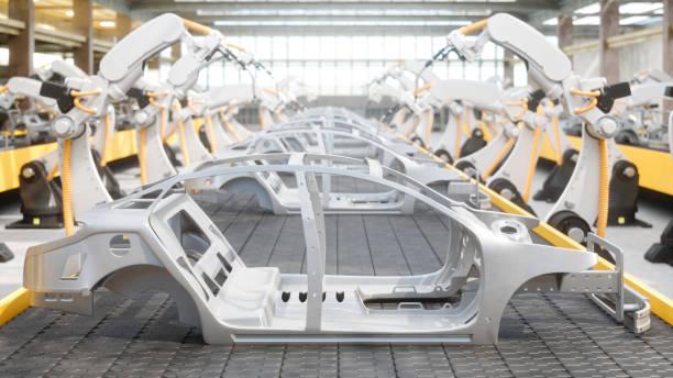 industria 4.0 - robot industriali presso la linea di assemblaggio automatico della fabbrica di automobili - metal robot in logistic factory foto e immagini stock