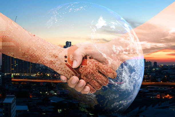 Industry 4.0 internet of things and digital disruption concept. Double exposure of Shaking hands of male people and robot circuit electronic hand with construction building and earth furnished by NASA stock photo