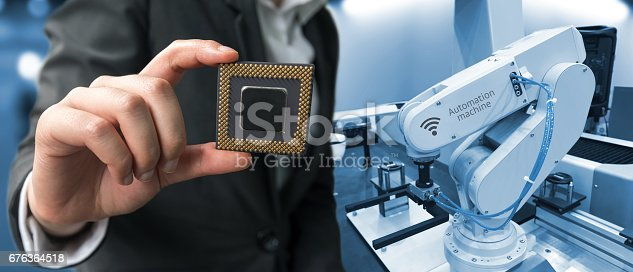 676364668 istock photo Industry 4.0 , Machine learning and artificial intelligence concept. Man suit hand holding Ai chipsets and blue tone of automate wireless Robot arm in smart factory background 676364518