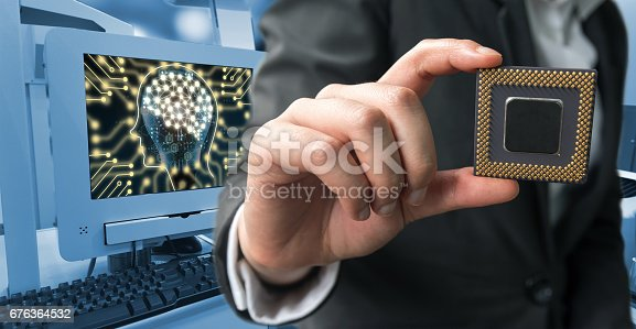 istock Industry 4.0 , Machine learning and artificial intelligence concept. Man suit hand holding Ai chipsets and blue tone of automate wireless Robot arm in smart factory background 676364532