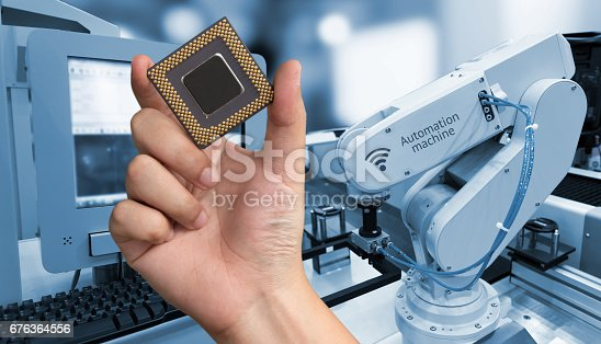istock Industry 4.0 , Machine learning and artificial intelligence concept. Man suit hand holding Ai chipsets and blue tone of automate wireless Robot arm in smart factory background with flare light effect 676364556
