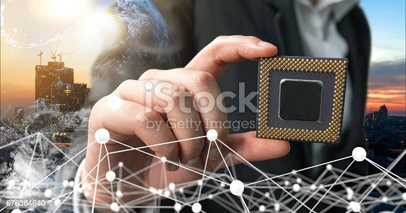676364668 istock photo Industry 4.0 , Machine learning and artificial intelligence concept. Man suit hand holding Ai chipsets and 3d rendering gears with flare light effect 676364640