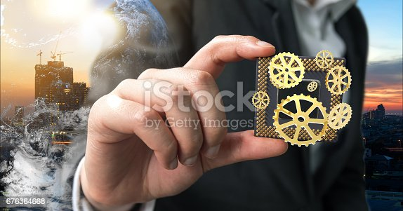istock Industry 4.0 , Machine learning and artificial intelligence concept. Man suit hand holding Ai chipsets and 3d rendering gears with flare light effect 676364668