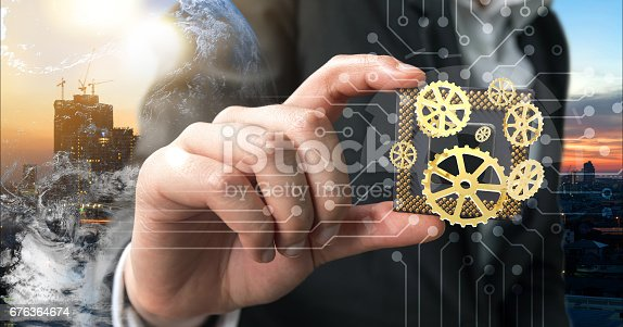 istock Industry 4.0 , Machine learning and artificial intelligence concept. Man suit hand holding Ai chipsets and 3d rendering gears with flare light effect 676364674