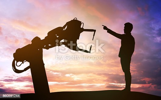 istock Industry 4.0 technology , artificial intelligence trend concept. Silhouette of business man point finger forward to heavy automation robot arm machine. Vivid twilight sunset sky background. 860591244