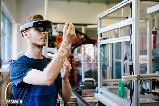 industry 4.0: Young engineer works with a head-mounted display