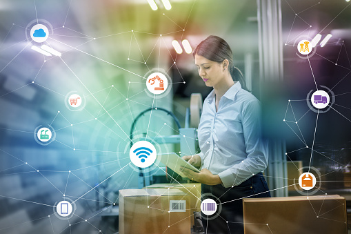 Industry And Internet Of Things Concept Woman Working In Factory And Wireless Communication Network Industry40 Stock Photo - Download Image Now