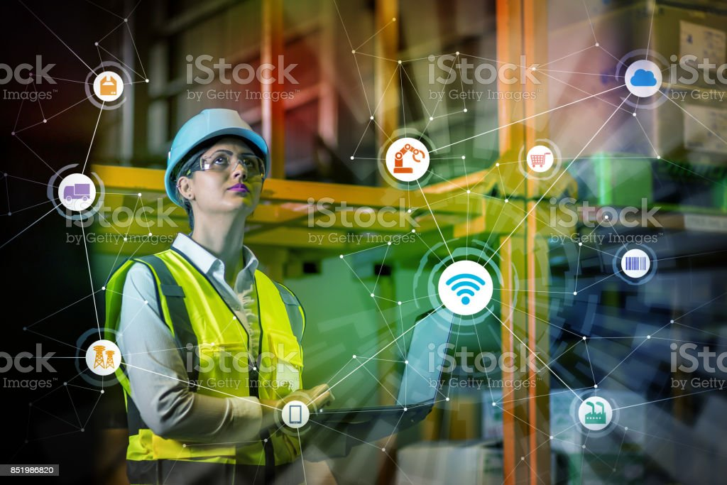 industry and Internet of Things concept. woman working in factory and wireless communication network. Industry4.0. industry and Internet of Things concept. woman working in factory and wireless communication network. Industry4.0. Abstract Stock Photo