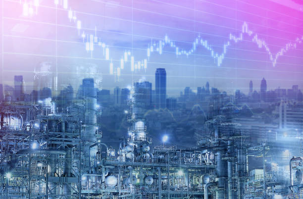 Industry business background. Oil refinery with city and graphice stock chart multiple exposure.