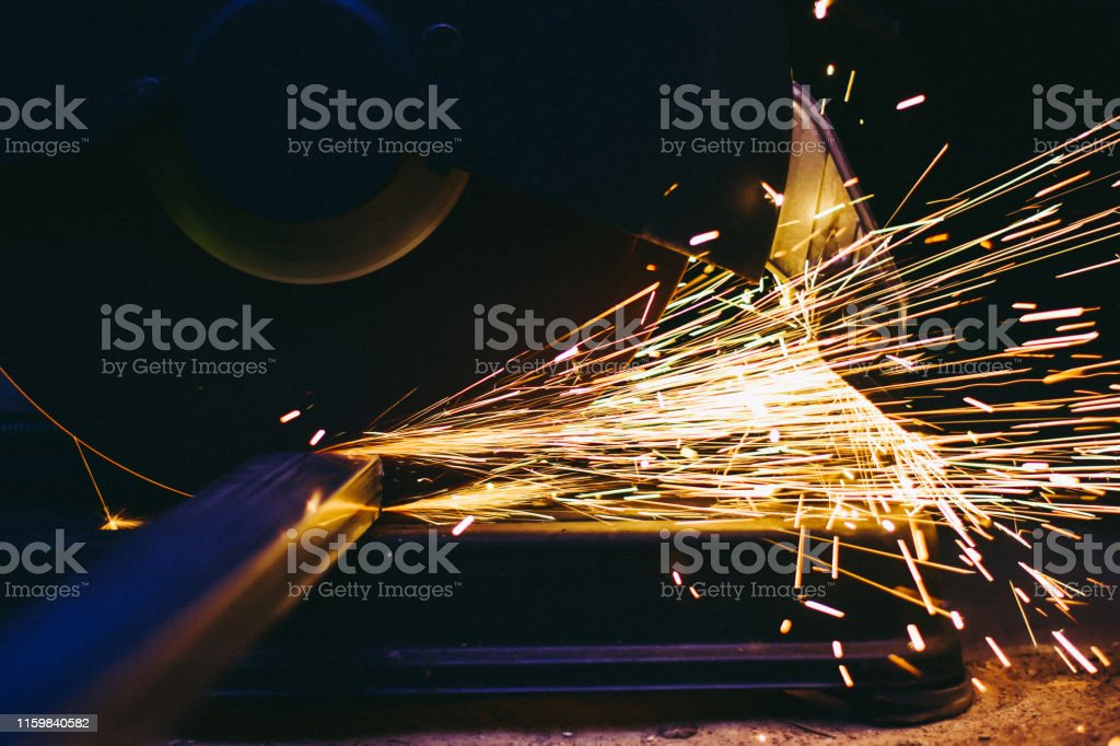 Industry electric fiber cutting steel with beautiful flash of sparks,...