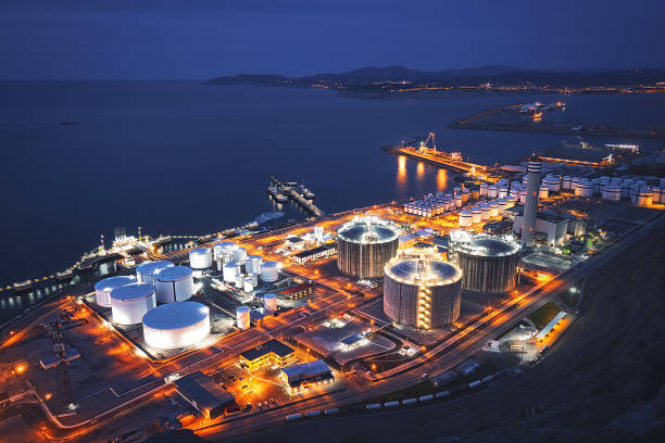industry in bilbao near the sea - refinery stock photos and pictures