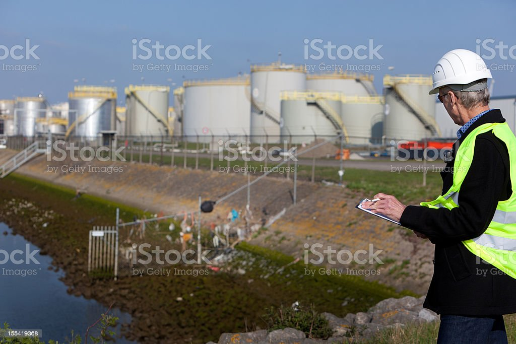 Industry inspector with garbage stock photo