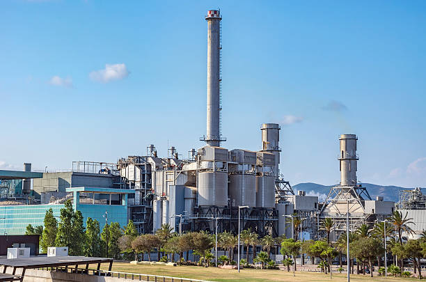 industry plant in barcelona - cogeneration plant stock photos and pictures