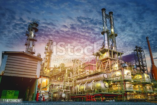 Industrial furnace and heat exchanger cracking hydrocarbons in petroleum factory on sky sunset background, Manufacturing of petrochemical plant