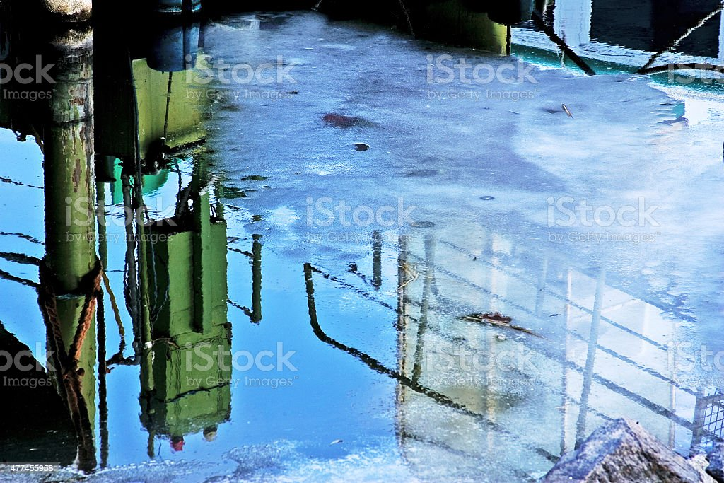 Industry reflections in the water stock photo