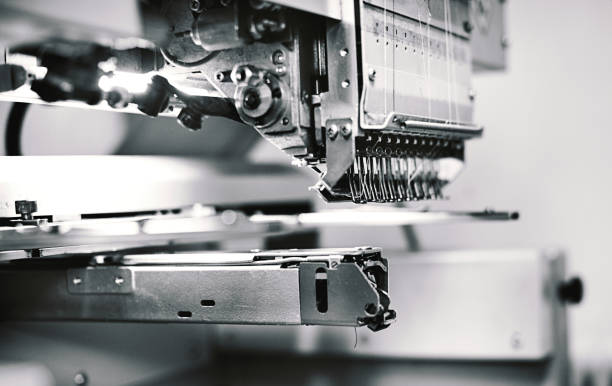 industry sewing machine. - embroidery machine stock pictures, royalty-free photos & images