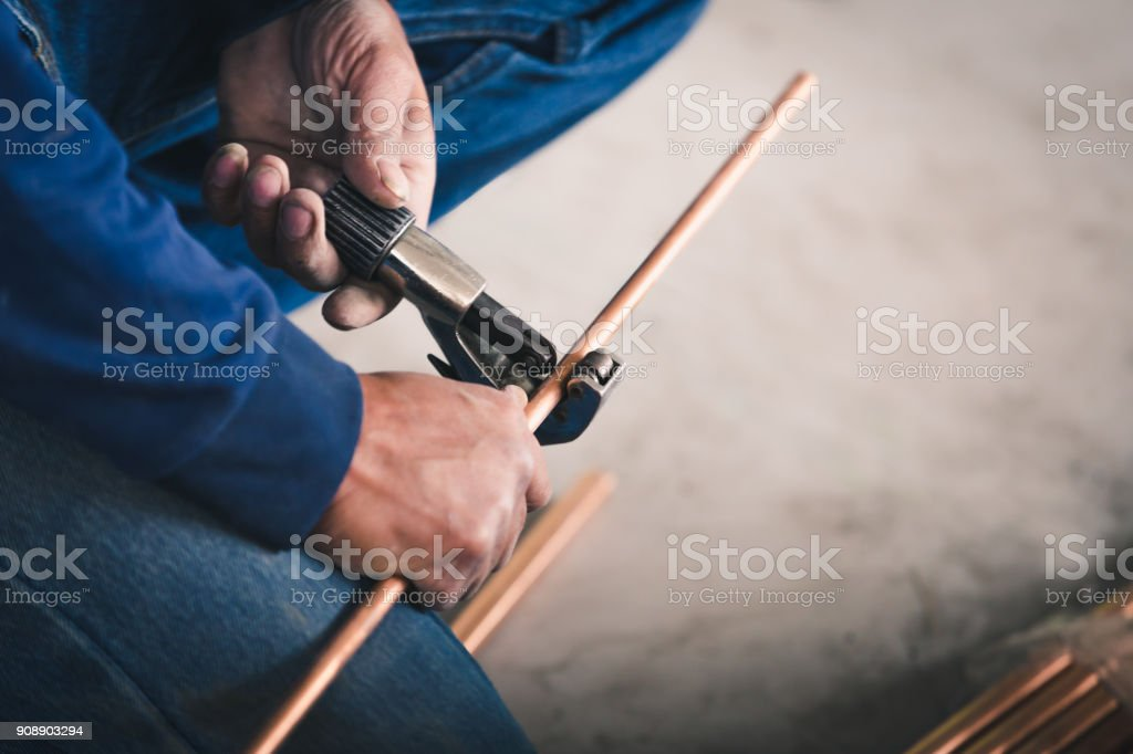 Industry system men worker cut joint with tool of copper stock photo