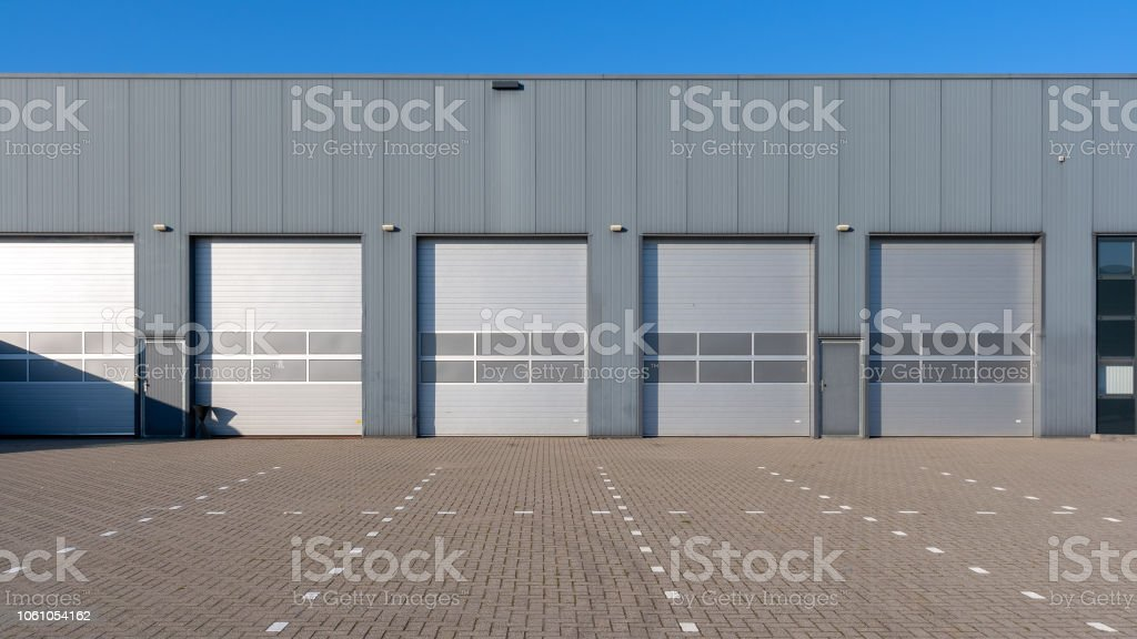 Industry units warehouse with shutter doors stock photo