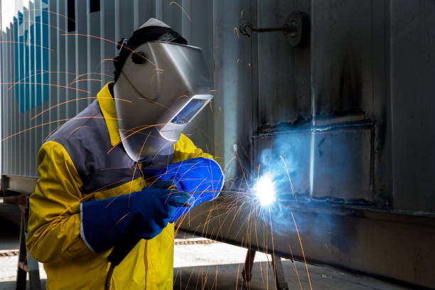 Industry worker with welding steel to repair container stock photo