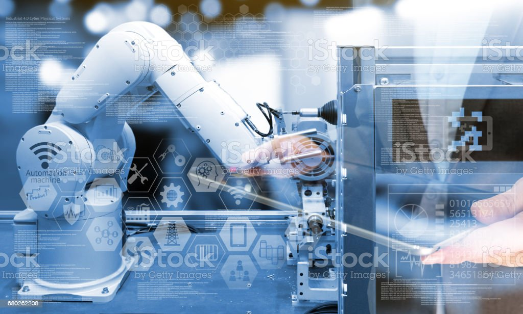 Industry4.0 concept .Business man holding tablet with industry graphic sign and blue tone of automate wireless Robot arm in smart factory background. Double exposure , blue tone stock photo